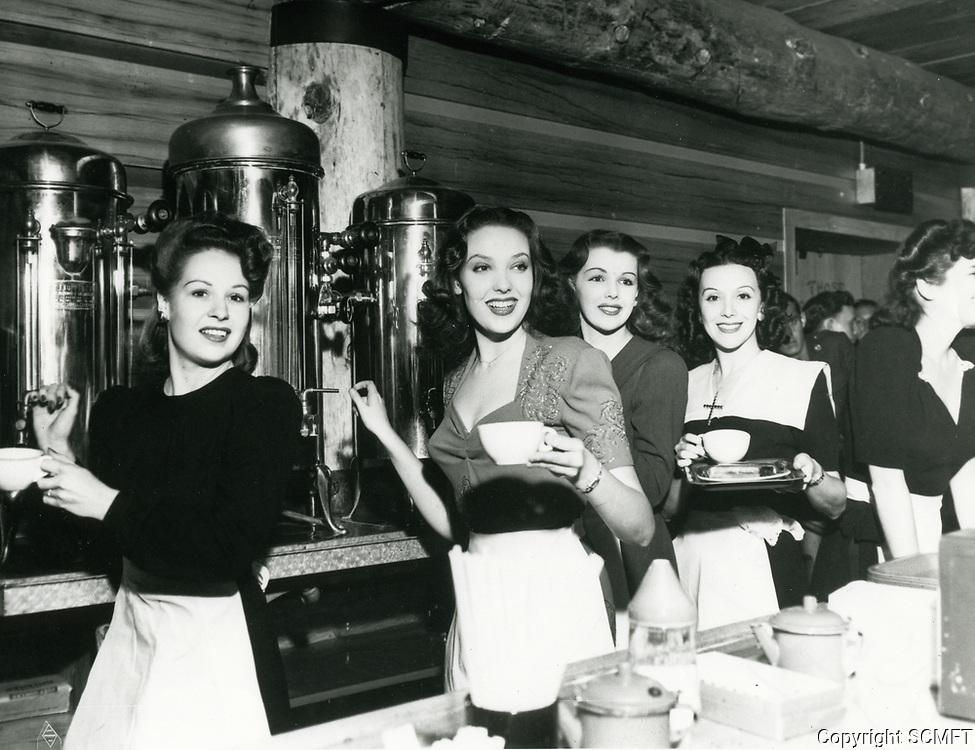 1944 Linda Darnell (2nd from left) & Claire James (3rd from left) and other hostesses serve coffee at the Hollywood Canteen