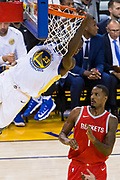 Golden State Warriors forward Draymond Green (23) dunks the ball against the Houston Rockets at Oracle Arena in Oakland, Calif., on October 17, 2017. (Stan Olszewski/Special to S.F. Examiner)