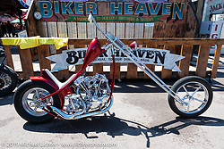 Custom builder Hawke Lawshe's exposed rocker Shovelhead chopper at the Broken Spoke area of the Sturgis Iron Horse Saloon during the Sturgis Black Hills Motorcycle Rally. Sturgis, SD, USA. Sunday, August 4, 2019. Photography ©2019 Michael Lichter.