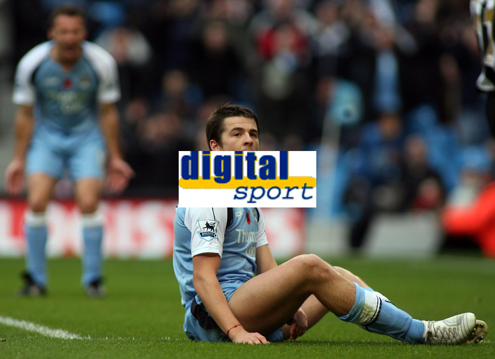 """Photo: Paul Thomas.<br /> Manchester City v Newcastle United. The Barclays Premiership. 11/11/2006.<br /> <br /> Man City's Joey Barton (R) can't believe he missed a good chance to score, while Paul Dickov (L) screams at him, """"he should have passed it instead""""."""