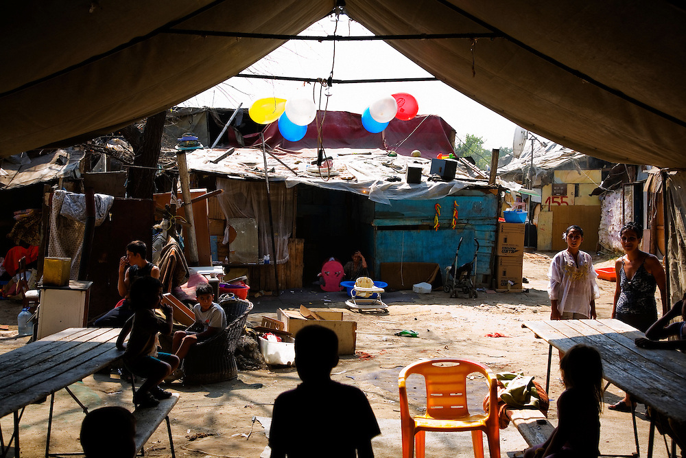 A muslim Roma family, presumably Kosovo refugees, prepare a large tent for their party to celebrate the circumcision of their young son. Nova Gazela.