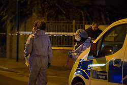 © Licensed to London News Pictures.24/11/2020. London, UK. Police officers gather evidence at a crime scene in Hoxton Street Market, east London, following a firearm discharge at around 2:20pm today - no reports of any injuries at the scene. London Photo credit: Marcin Nowak/LNP