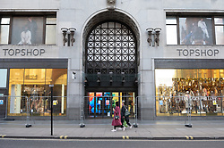 © Licensed to London News Pictures. 22/01/2021. London, UK. Exterior photo show the Topshop flagship store in Oxford Circus with a security fence. It is reported the 90,000 ft building owned by the Arcadia group is to be sold. The Arcadia group fell into administration last year due to falling sale and the Covid-19 lockdfown restrictions. Photo credit: Ray Tang/LNP