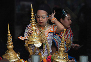 Ceremonial dancers at Bangkok's Erawan Shrine wear plastic visors to protect themselves from Covid 19