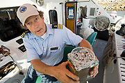 Captain Charles Moore, the man credited for first discovering the plastic soup in the Gyre, showing plastic samples collected in the North Pacific Gyre.