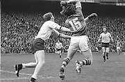 Kerry dives at Dublin in an attempt to stop him from throwing the ball during the All Ireland Senior Gaelic Football Final Dublin v Kerry in Croke Park on the 26th September 1976. Dublin 3-08 Kerry 0-10.