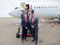 CARDIFF, WALES - Saturday, June 4, 2016: FAW Chief-Executive Jonathan Ford and FAW President David Griffiths pose for a photograph with members of the FAW Council on the steps of the aircraft at Cardiff Airport as the Wales football squad head to Sweden for their last friendly before the UEFA Euro 2016 in France. (Pic by Paul Greenwood/Propaganda)