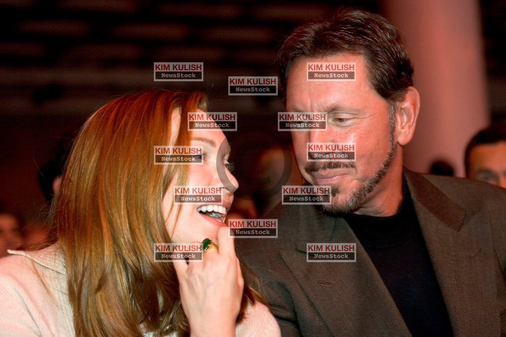 Melanie Ellison smiles and laughs with her husband Larry Ellison, CEO Oracle Corp.,  during the Oracle Open World 2005 conference, September 21, 2005 in San Francisco, California.   Photo by Kim Kulish/