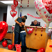 """Juan Lugo kisses his wife Valerie after Judge Charlie Espinoza married them in his Hidalgo County Justice of the Peace Pct. 4, Place 1 office in Edinburg. Juan and Valerie, who have been together for nearly four years and have a son together, woke up on Valentines Day morning and decided that it was the day they should get married. Judges at the Hidalgo County Courthouse and Justice of the Peace offices kept busy performing walk-in marriages for those who wanted to make Valentines Day the day to say """"I do.""""<br /> Nathan Lambrecht/The Monitor"""