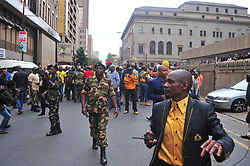 JOHANNESBURG, SOUTH AFRICA – APRIL 07: MKMVA members and Luthuli House security move to assist police in creating a cordon preventing ANCYL members attacking returning DA marchers, in Johannesburg, South Africa, 07 April 2017. Businesses closed and South Africans from numerous political, religious, labour and civic groups gathered at central points across the entire country protesting against President Zuma's recent government reshuffle appointing 10 new ministers and 10 new deputy ministers including the axing of the finance minister. Photo: Dino Lloyd