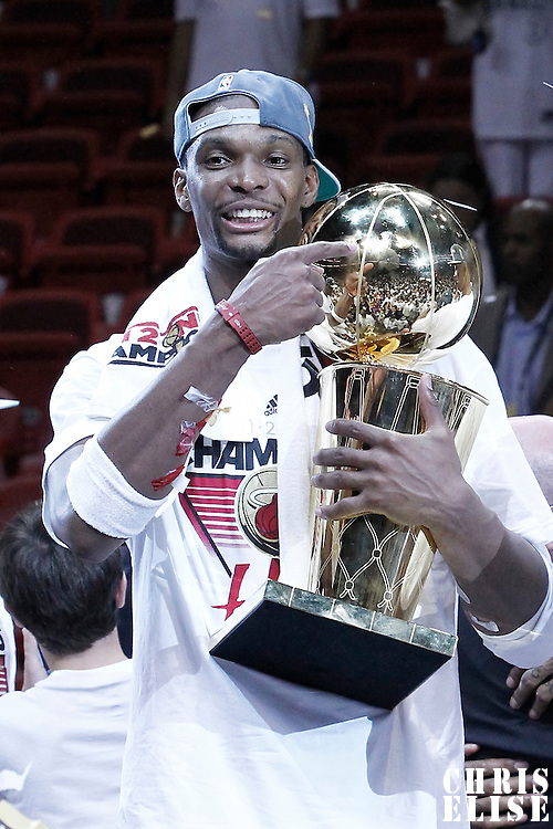 21 June 2012: Miami Heat power forward Chris Bosh (1) holds the championship trophy after the Miami Heat 121-106 victory over the Oklahoma City Thunder, in Game 5 of the 2012 NBA Finals, at the AmericanAirlinesArena, Miami, Florida, USA. The Miami Heat wins the series 4-1.