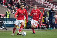 Keshi Anderson of Swindon Town on the ball with Paul Caddis of Swindon Town during the EFL Sky Bet League 2 match between Swindon Town and Forest Green Rovers at the County Ground, Swindon, England on 7 March 2020.