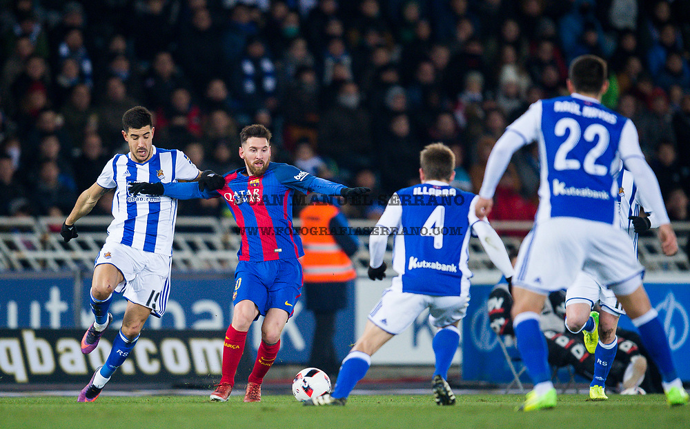 SAN SEBASTIAN, SPAIN - JANUARY 19:  Lionel Messi of FC Barcelona duels for the ball with Yuri Berchiche of Real Sociedad during the Copa del Rey Quarter Final, First Leg match between Real Sociedad de Futbol and FC Barcelona at Estadio Anoeta on January 19, 2017 in San Sebastian, Spain.  (Photo by Juan Manuel Serrano Arce/Getty Images)