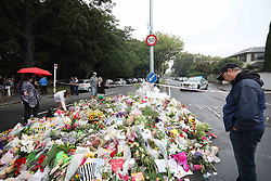 March 18, 2019 - Christchurch, New Zealand - People place flowers outside the Al Noor mosque as a tribute to victims of the mosque attacks in Christchurch on March 17, 2019. At least 50 people were killed and 36 injured in mass shootings at two mosques in the New Zealand city of Christchurch Friday, 15 March. A 28-year-old Australian born man appeared in Christchurch District Court on Saturday charged with murder. (Credit Image: © Sanka Vidanagama/NurPhoto via ZUMA Press)