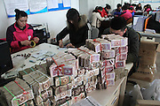 BINZHOU, CHINA - JANUARY 23: (CHINA OUT) <br /> <br /> Man Takes Money in to Car showroom To Buy Vehicle <br /> <br /> Workers of a 4S shop count the small change from a man who brings these money to buy a vehicle on January 23, 2016 in Binzhou, Shandong Province of China. Mr. Pang brought over 52,000 yuan (7,904 USD) consisting of small change to afford the down payment of a vehicle at a 4S shop in Binzhou. Pang sold plastic packages and received these small change from the vendors.<br /> ©Exclusivepix Media