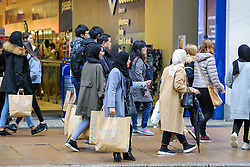 © Licensed to London News Pictures. 23/12/2018. London, UK. Last minute Christmas shoppers with Premark bags takes advantage of pre-Christmas bargains in London's Oxford Street. Fewer shoppers have been reported shopping in Britain's high streets as online sales increase. Photo credit: Dinendra Haria/LNP