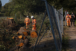 HS2 workers carry out tree felling works alongside the Grand Union Canal in connection with the HS2 high-speed rail link on 21 September 2020 in Harefield, United Kingdom. Anti-HS2 activists continue to try to prevent or delay works for the controversial £106bn HS2 high-speed rail link on environmental and cost grounds from a series of protection camps based along the route of the line between London and Birmingham.