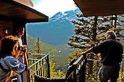 Alaska, Skagway. Tourists enjoying a ride on the historic White Pass & Yukon Railroad. Summer.