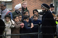 British police constable seen wearing his traditional styled police turban whilst on duty in Southall, london in 1991. Photograph by Jayne Fincher
