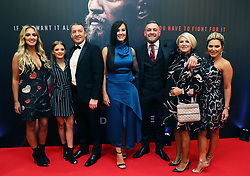 Conor McGregor with his partner Dee Devlin (centre), father Tony, mother Margaret, and sisters Erin (right) and Aoife (left) on arrival at the Conor McGregor: Notorious premiere at the Savoy Cinema in Dublin.