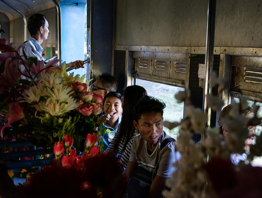 YANGON, MYANMAR - CIRCA DECEMBER 2017: People inside a typical wagon of the Yangon circular railway service.