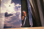 Speaker Newt Gingrich on phone in the speakers office looking out at the mall<br />hoto by Dennis Brack
