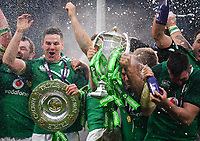 LONDON, ENGLAND - MARCH 17: Ireland players celebrate with the Triple Crown Trophy after the NatWest Six Nations Championship match between England and Ireland at Twickenham Stadium on March 17, 2018 in London, England. (Photo by Ashley Western - MB Media via Getty Images)