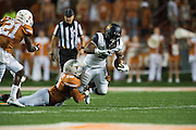 AUSTIN, TX - SEPTEMBER 19:  Tre Watson #5 of the California Golden Bears is brought down by Peter Jinkens #19 of the Texas Longhorns on September 19, 2015 at Darrell K Royal-Texas Memorial Stadium in Austin, Texas.  (Photo by Cooper Neill/Getty Images) *** Local Caption *** Tre Watson; Peter Jinkens