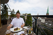 Aleksandrs Antonenko, a young Latvian star tenor with Ukranian roots, living in Riga. Here at Gutenbergs Restaurant above the roofs of Riga.