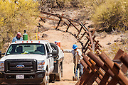 "03 MAY 2012 - VEKOL VALLEY, RURAL PINAL COUNTY, AZ:    Eric Reynolds (CQ LEFT) and James Peters (CQ) both from the BLM office in Safford, work on vehicle barriers on Bureau of Land Management land south of Interstate 8 and west of Casa Grande in rural Pinal County. The area has been a hotbed of illegal immigrant and drug smuggling for years. The BLM has undertaken a series of ""surges"" in the area, increasing their law enforcement patrols and partnering with Border Patrol and Pinal County Sheriff's Department officers to reduce criminal activity in the area.       PHOTO BY JACK KURTZ"