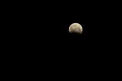 August 8, 2017 - Beitun, Beitun, China - Beitun, CHINA-August 8 2017: (EDITORIAL USE ONLY. CHINA OUT) ..The lunar eclipse can be seen over Beitun, northwest China's Xinjiang Uygur Autonomous Region. (Credit Image: © SIPA Asia via ZUMA Wire)