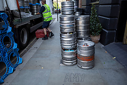 © Licensed to London News Pictures. 23/07/2021. LONDON, UK.  A delivery of casks of beer takes place outside the Hawley Arms, Amy Winehouse's favourite pub in Camden Town, next to the word Amy on the pavement on the tenth anniversary of the late singer's death.  Photo credit: Stephen Chung/LNP