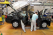Mlada Boleslav/Tschechische Republik, Tschechien, CZE, 16.03.07: Mitarbeiter beim Türen montieren am Fertigungsband mit einem Skoda Octavia in der Skoda Auto Fabrik in Mlada Boleslav. Der tschechische Autohersteller Skoda ist ein Tochterunternehmen der Volkswagen Gruppe.<br /> <br /> Mlada Boleslav/Czech Republic, CZE, 16.03.07: Workers at the Skoda factory install car doors into Octavia model on the main assembly line at Skoda car factory in Mlada Boleslav. Czech car producer Skoda Auto is subsidiary of the German Volkswagen Group (VAG).