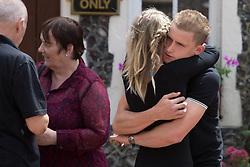 © Licensed to London News Pictures. 29/07/2016. Brighton, UK. Funeral of Sam Caulfield 20 from Mayfield who was stabbed in a flat in Crawley on the 8th of August 2016. Funeral was at Woodvale Crematorium, Lewes Road, Brighton.  Friends and family attend. Closes friends carry the coffin. Photo credit: Grant Melton/LNP