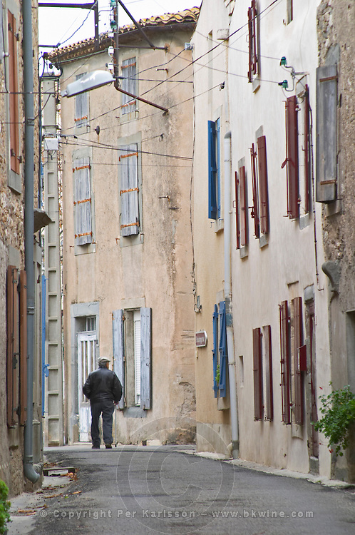 Domaine Entretan, J-C and D Plantade in Roubia. Minervois. Languedoc. A man walking on the street. France. Europe.
