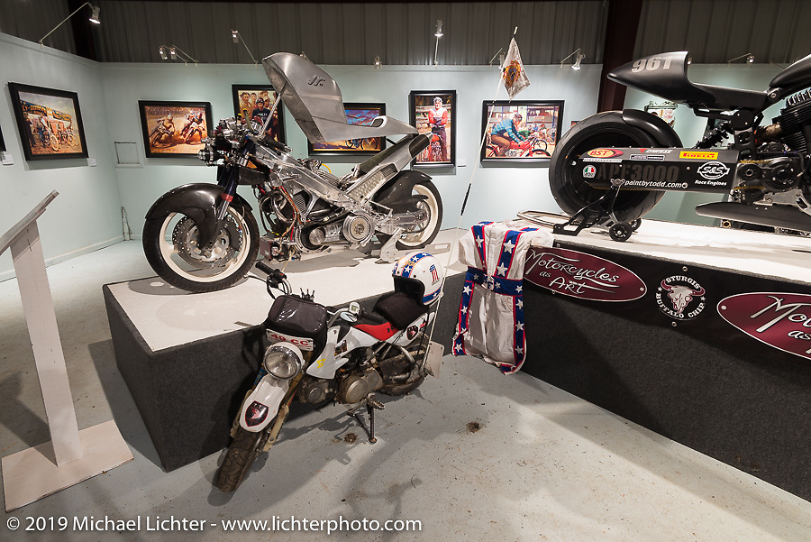 "John Reed's EuroV custom along with Bean're's min-bike and a Confederate in the ""Built for Speed"" exhibition curated by Michael Lichter and Paul D'Orleans in the Russ Brown Events Center as part of the annual ""Motorcycles as Art"" series at the Sturgis Buffalo Chip during the Black Hills Motorcycle Rally. SD, USA. August 5, 2014.  Photography ©2014 Michael Lichter."