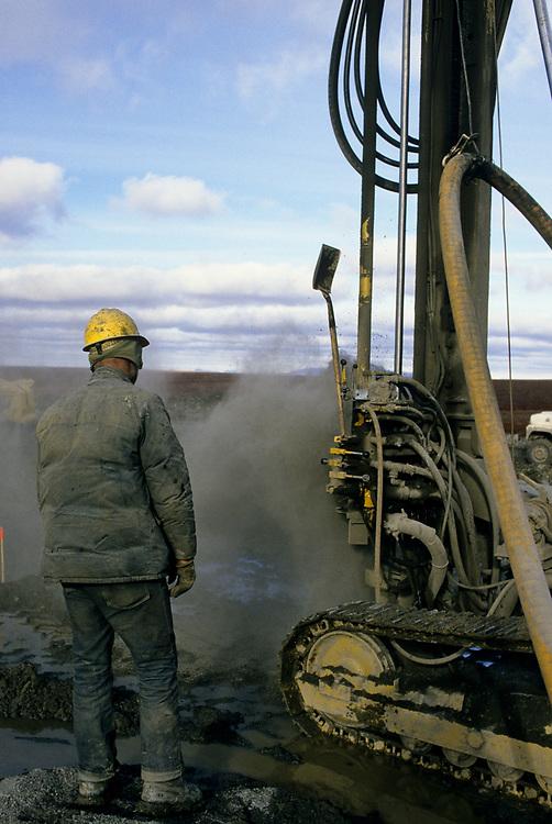 Alaska, Red Dog Mine. Drilling holes for blasting during road construction. Summer 1987.