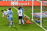 Football - 2020 / 2021 Sky Bet Championship - Swansea City vs Coventry City - Liberty Stadium<br /> <br /> Ben Cabango Swansea celebrates scoring his team's first goal as Ben Wilson of Coventry City lies on his back with the ball in the back of the net<br /> <br /> COLORSPORT/WINSTON BYNORTH