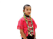 Maria 10, an ethnic Kayaw girl at Baan Tong Luang, Eco-Agricultural Hill Tribes Village on 7th June 2016 in Chiang Mai province, Thailand. The fabricated village is home to 8 different hill tribes who make a living from selling their handicrafts and having their photos taken by tourists