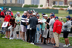 June 12, 2019 - Pebble Beach, CA, U.S. - PEBBLE BEACH, CA - JUNE 12: PGA golfer Brooks Koepka signs autographs after finishing the 9th hole during a practice round for the 2019 US Open on June 12, 2019, at Pebble Beach Golf Links in Pebble Beach, CA. (Photo by Brian Spurlock/Icon Sportswire) (Credit Image: © Brian Spurlock/Icon SMI via ZUMA Press)