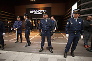"February 5, 2017, Tokyo, Japan: Tokyo Metropolitan police officers cordoned off the entrance to APA Hotel's Shinjuku Gyoenmae branch during a demonstration by ultra-right wingers angered by APA's planned removal of a controversial history revisionist book from hotel rooms hosting athletes of the 2017 Sapporo Asian Winter Games. The book in question written by Toshio Motoya, the hotel chain's Chief Executive, claims the 1937 Nanjing Massacre was a fabrication. Writing under the pen name Seiji Fuji, Motoya's book entitled ""Theoretical Modern History II"" is placed in every APA Hotel room in Japan and sold at their reception desks. The Tokyo based APA Hotel group is one of the largest hotel chains in Japan with over 400 hotels across the country. In the past 2-3 years APA has benefitted from a tourism boom to Japan in which 40% of their guests are foreign visitors and half that amount are Chinese and Korean nationals. As a result, China and Korea have been outraged by APA and a large boycott began in late January by both countries. This led to APA announcing they would pull Motoya's books from athlete's rooms only during the Asian Winter Games, infuriating Japanese right wingers. The demonstrators at this event are part of a group who call themselves ""Group of Warriors Protecting the Nation"" (Gokoku Shishi no Kai). Photo by Torin Boyd."