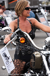 "Amy Woodard checks out a new 2016 Harley-Davidson ""72"" Sportster at the HD display at Daytona International Speedway during Daytona Bike Week's 75th Anniversary event. FL, USA. Saturday March 12, 2016.  Photography ©2016 Michael Lichter."