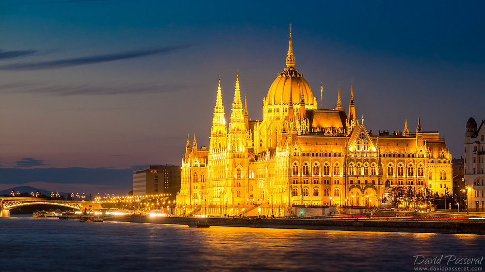 Budapest parliament in golden lights at blue hour.