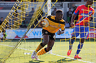 Newport's David Tutonda hurriedly picks the ball out of the net as he celebrates after scoring his sides first goal. Skybet football league two match , Newport county v Dagenham & Redbridge at Rodney Parade in Newport, South Wales on Saturday 18th April 2015.<br /> pic by David Richards, Andrew Orchard sports photography.