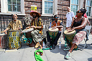 A band of British-African drummers tune into the speakers voices as they address racial injustice to the crowd of anti-police brutality protestors carrying banners, placards and flags in front of Tottenham Police Station in North London on Saturday, Aug 8, 2020. <br /> Black Lives Matter enters the 11th weekend of continuous demonstrations against racial injustice in Britain. <br /> Anger against systemic levels of institutional racism have raged and continued throughout the United States, Britain and worldwide; sparked by the death of George Floyd who died on May 25 after he was restrained by Minneapolis police in the United States. (VXP Photo/ Vudi Xhymshiti)