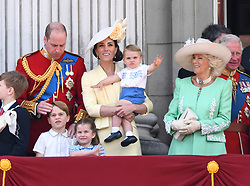 The Duke of Cambridge, Prince George, Prince Louis, Princess Charlotte, The Duchess of Cambridge, The Duchess of Cornwall and Prince Charles attending Trooping The Colour, Buckingham Palace, London. Picture credit should read: Doug Peters/EMPICS