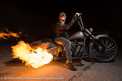 Fred Kodlin warming up his latest custom bagger after displaying it at Motor Bike Expo. Verona, Italy. Sunday January 21, 2018. Photography ©2018 Michael Lichter.