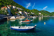 Fishing boats and blue waters in the village of Sobra, Mljet Island, Croatia