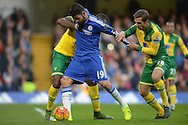 Diego Costa of Chelsea is pulled by Sebastien Bassong of Norwich City and Gary O'Neil of Norwich City. Barclays Premier league match, Chelsea v Norwich city at Stamford Bridge in London on Saturday 21st November 2015.<br /> pic by John Patrick Fletcher, Andrew Orchard sports photography.