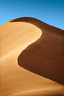 sand being blown on Sahara sand dunes of erg Chebbi, Morocco, Africa